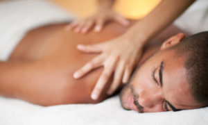 Tena: Man receiving back massage.